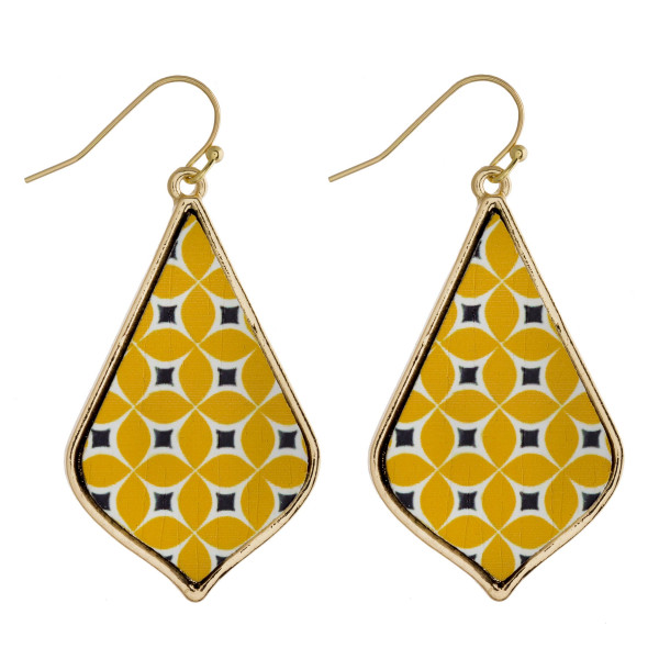 """Long wooden drop earrings featuring a yellow flower inspired pattern. Approximately 2"""" in length."""