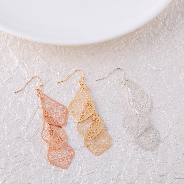"Long filigree inspired earrings featuring trio accents. Approximately 2.5"" in length."