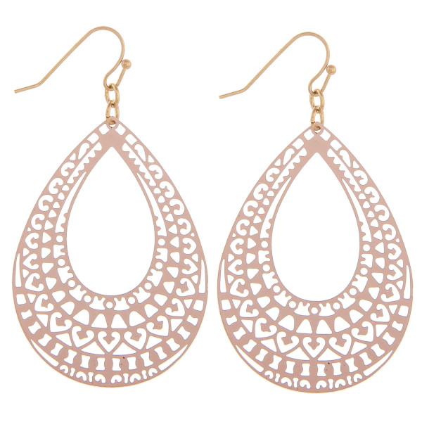 "Teardrop earrings featuring an open center and a filigree pattern. Approximately 2"" in length."
