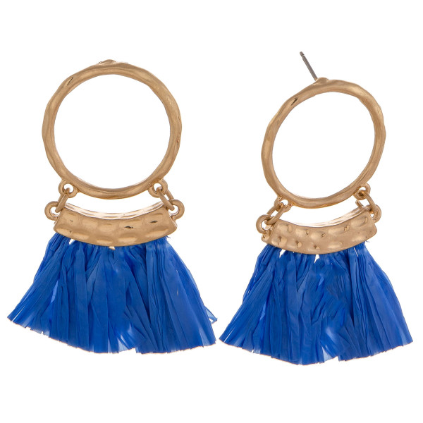 "Circular drop earrings featuring blue tassels and gold accents. Approximately 2"" in length."