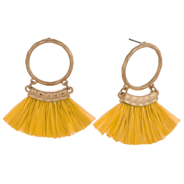 "Circular drop earrings featuring yellow tassels and gold accents. Approximately 2"" in length."