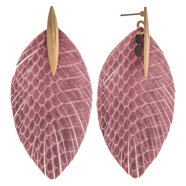 """Faux leather feather inspired earrings featuring snakeskin details and a metal stud accent. Approximately 3"""" in length."""