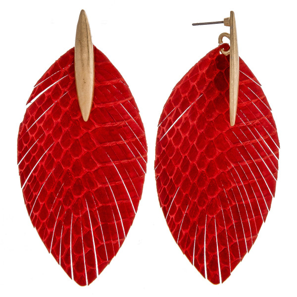"""Faux leather feather inspired earrings featuring snakeskin details with a metal stud accent. Approximately 3"""" in length."""