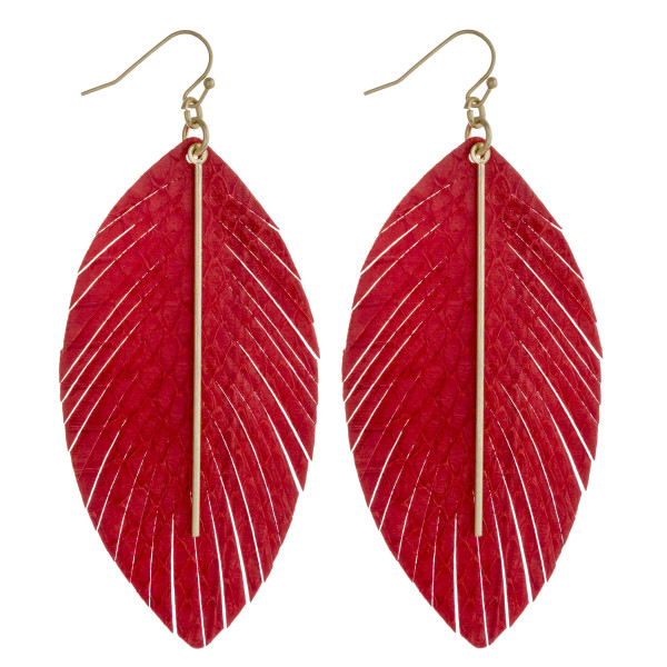 """Faux leather feather inspired earrings featuring a gold metal center accent. Approximately 3.5"""" in length."""