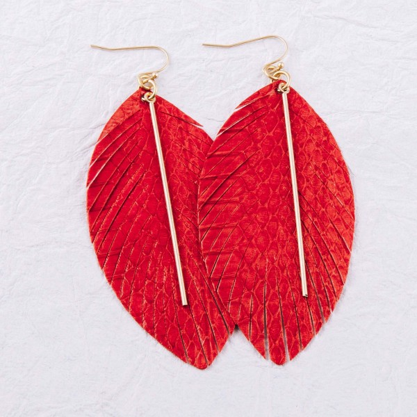 """Faux leather snakeskin feather dangle earrings featuring a gold bar accent. Approximately 3.5"""" in length."""