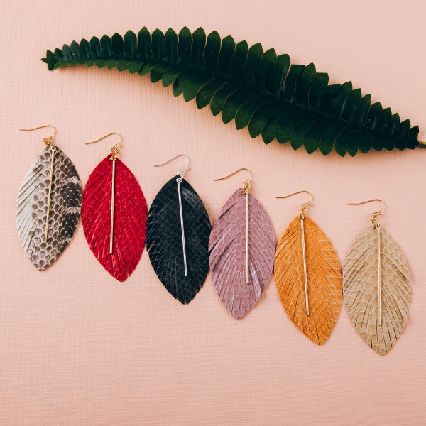 """Faux leather feather inspired earrings featuring snakeskin details with a silver bar accent. Approximately 3.5"""" in length."""