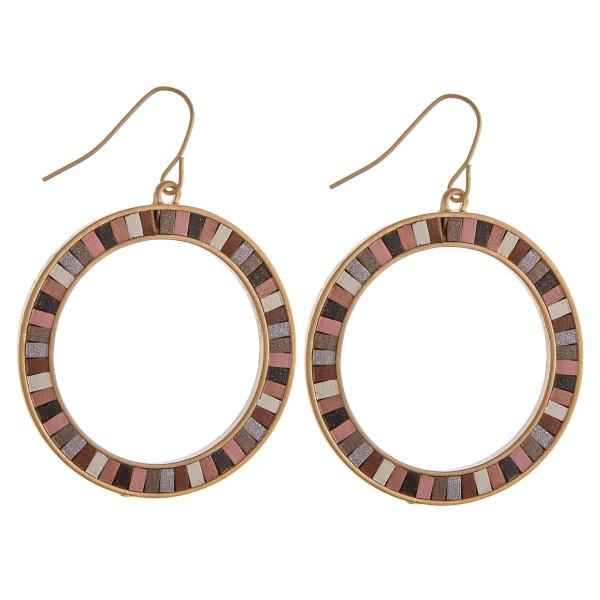 "Gold metal circular drop earrings featuring resin details. Approximately 1.5"" in diameter."