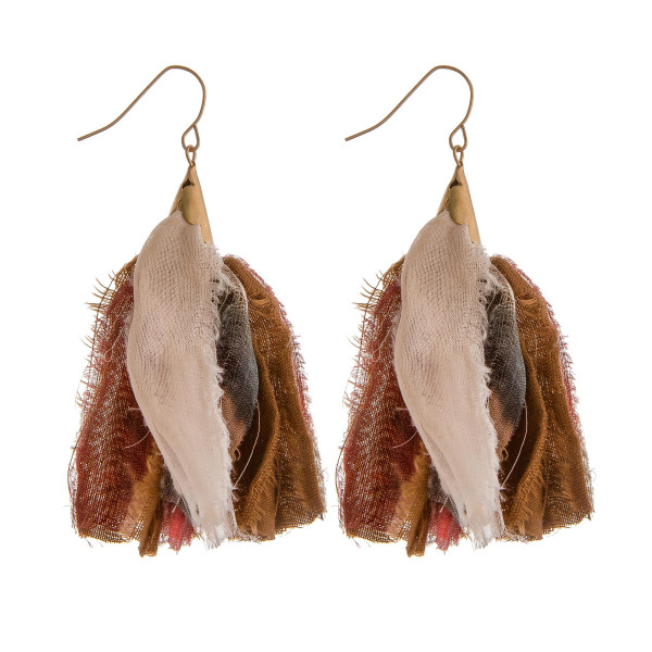 "Long drop earrings featuring natural fabric tassel accents. Approximately 2.75"" in length."