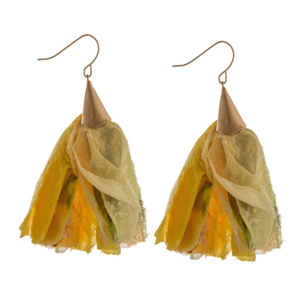 "Long drop earrings featuring yellow fabric tassel accents. Approximately 2.75"" in length."
