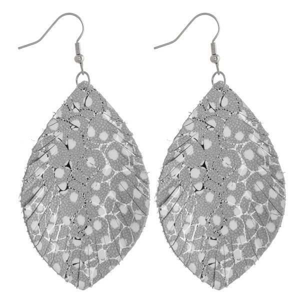 """Faux leather feather inspired earrings featuring silver metallic details and polka dot accents. Approximately 2.5"""" in length."""