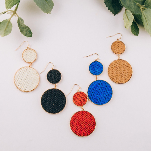 "Rattan woven double disc drop earrings. Approximately 2.5"" in length."