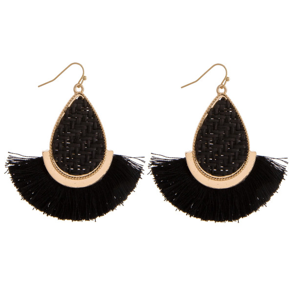 "Long teardrop earrings featuring a rattan woven center with gold metal accents and tassel details. Approximately 2"" in length."