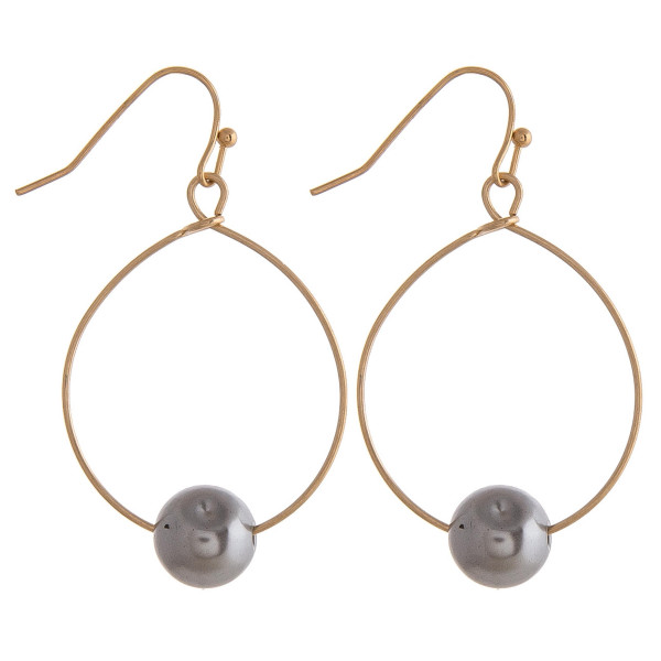 """Dainty circular earrings featuring a pearl accent. Approximately 1"""" in diameter."""
