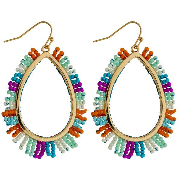 """Teardrop earrings featuring beaded tassel details. Approximately 2.5"""" in length."""