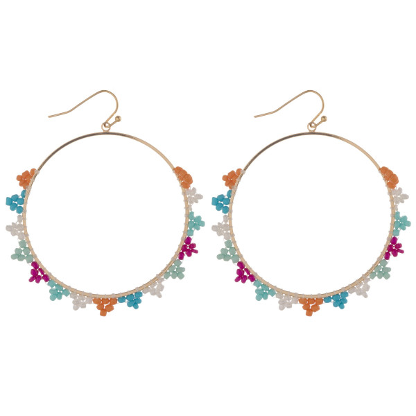 "Large circular earrings featuring seed beaded details. Approximately 2.5"" in diameter."