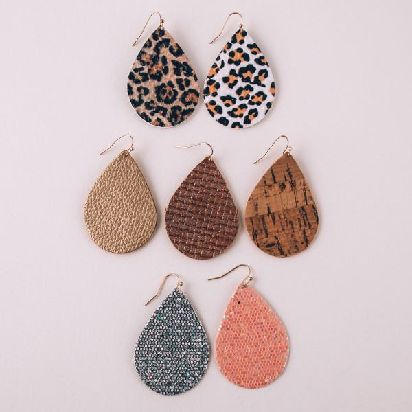 "Faux leather teardrop earrings featuring a bronze woven pattern. Approximately 2"" in length."