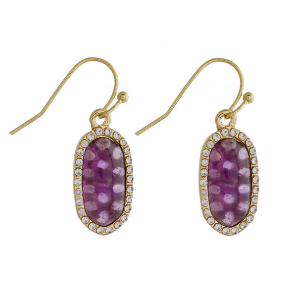 "Drop earrings featuring a purple natural stone and cubic zirconia details. Approximately .5"" in length."
