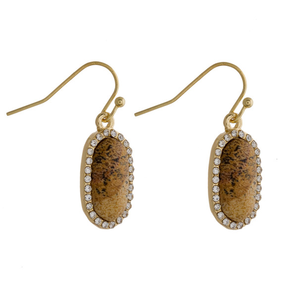 "Drop earrings featuring a jasper natural stone and cubic zirconia details. Approximately .5"" in length."