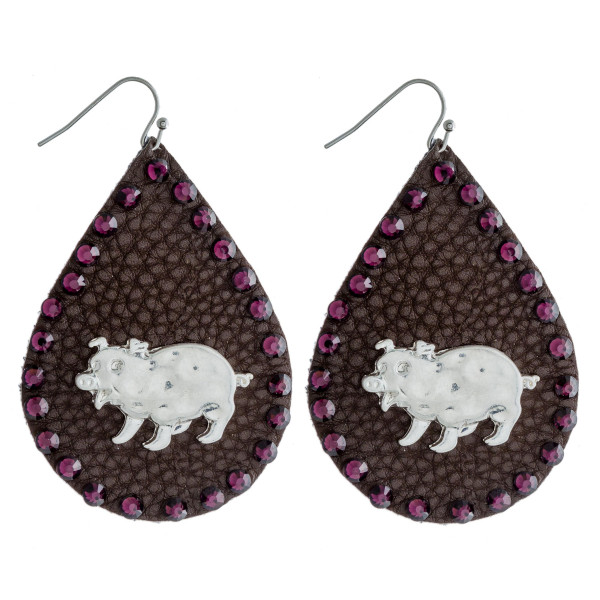 """Faux leather teardrop earrings featuring a metal pig detail and purple rhinestone accents. Approximately 2.5"""" in length."""