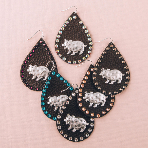 """Faux leather teardrop earrings featuring a metal pig detail and silver rhinestone accents. Approximately 2.5"""" in length."""