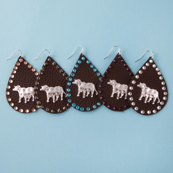 """Faux leather teardrop earrings featuring a metal cow detail and aqua rhinestone accents. Approximately 2.5"""" in length."""