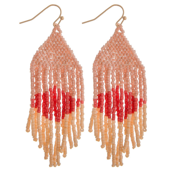 "Long pink mix boho beaded earrings. Measures approximately 2.75"" long."