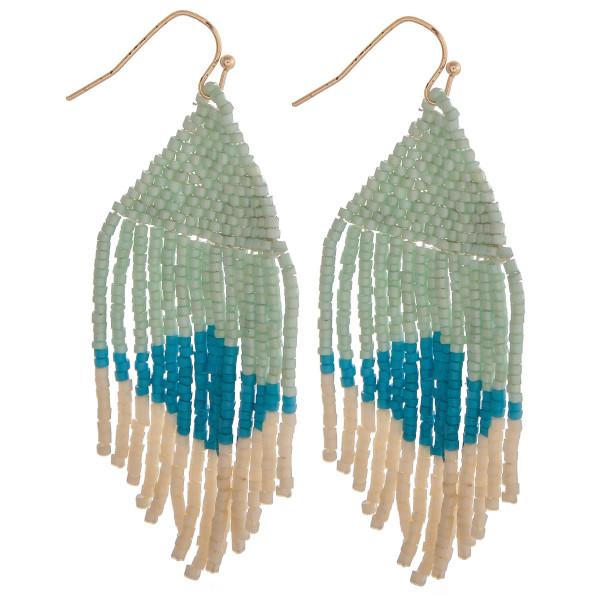 """Long mint mix boho beaded earrings. Measures approximately 2.75"""" long."""