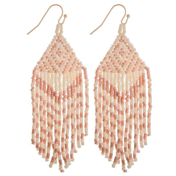 "Long pink boho beaded earrings. Measures approximately 2.75"" long."