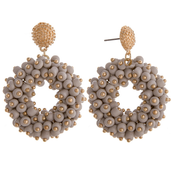 """Long grey circular beaded earrings with gold details. Measures approximately 1.5"""" long."""