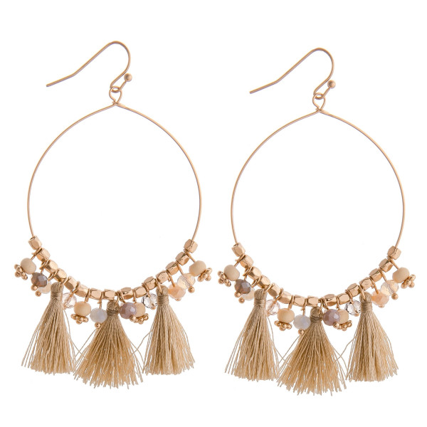 """Long natural mix beaded circular earrings featuring tassel details. Measures approximately 2.75"""" long."""