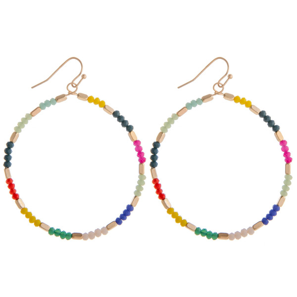 "Long hoop earrings featuring multi colored beaded details. Measures approximately 2"" long."