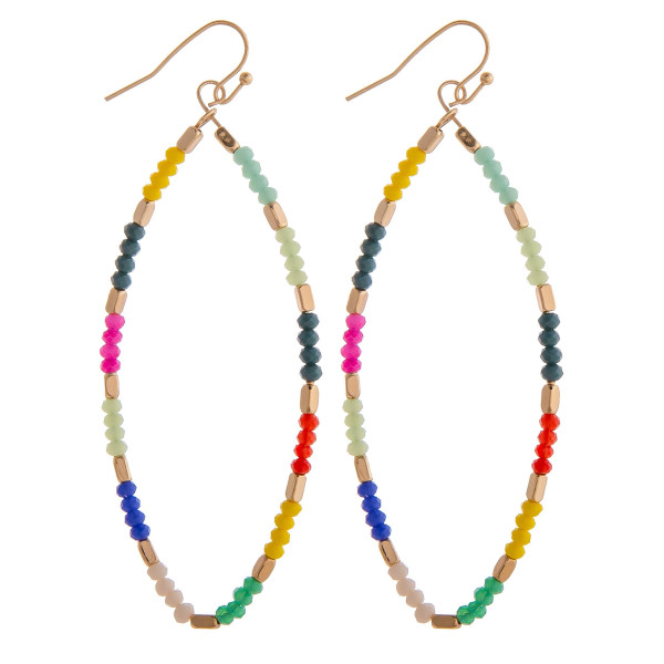 "Long football shaped earrings with multi colored beaded details. Measures approximately 3"" long."