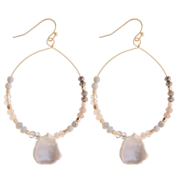 "Long baroque pearl circular earrings featuring natural colored beads. Measure approximately 2"" long."