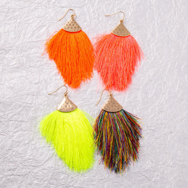 "Long drop earrings featuring neon tassel details and gold metal accents. Approximately 3.5"" in length."