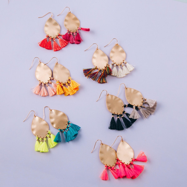 """Metal plated drop earrings featuring fuchsia tassel accents. Approximately 2"""" in length."""