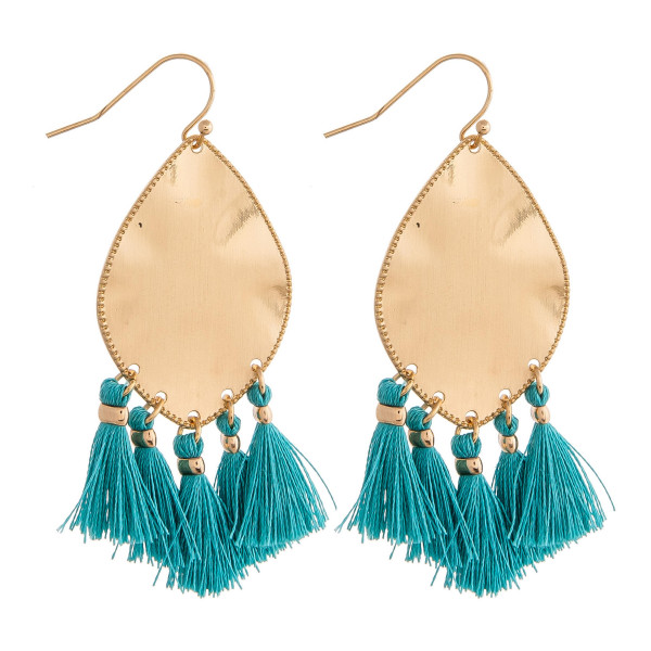 "Metal plated drop earrings featuring turquoise tassel accents. Approximately 2"" in length."