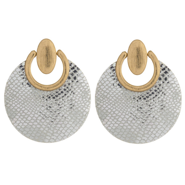 """Faux leather disc earrings featuring metallic snakeskin details an gold metal accents. Approximately 1.5"""" in diameter."""