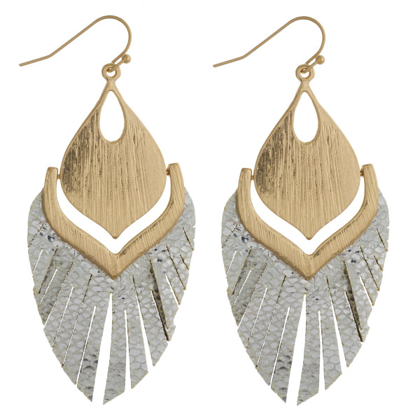 """Faux leather feather inspired earrings featuring metallic snakeskin tassel details and gold metal accents. Approximately 2.5"""" in length."""