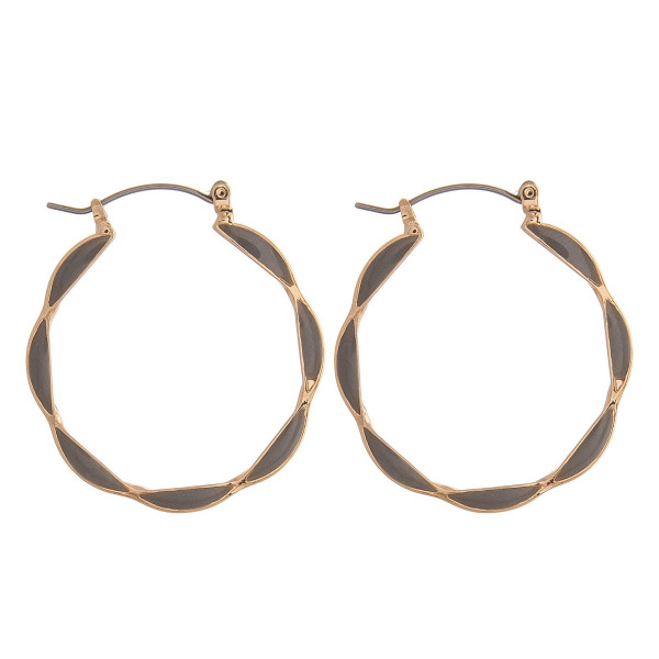 "Double sided metal hoop earrings featuring grey accents. Approximately 1.25"" in diameter."