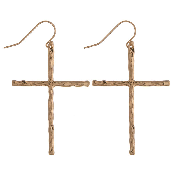 "Gold cross earrings featuring a wavy textured. Approximately 2"" in length."