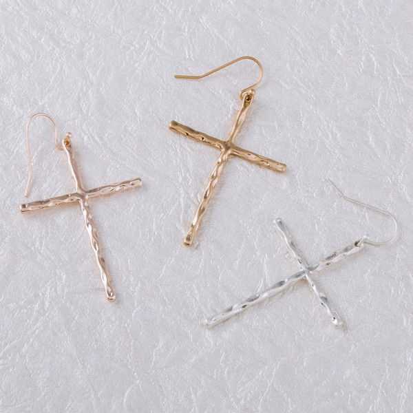 "Rose gold cross earrings featuring a wavy textured. Approximately 2"" in length."