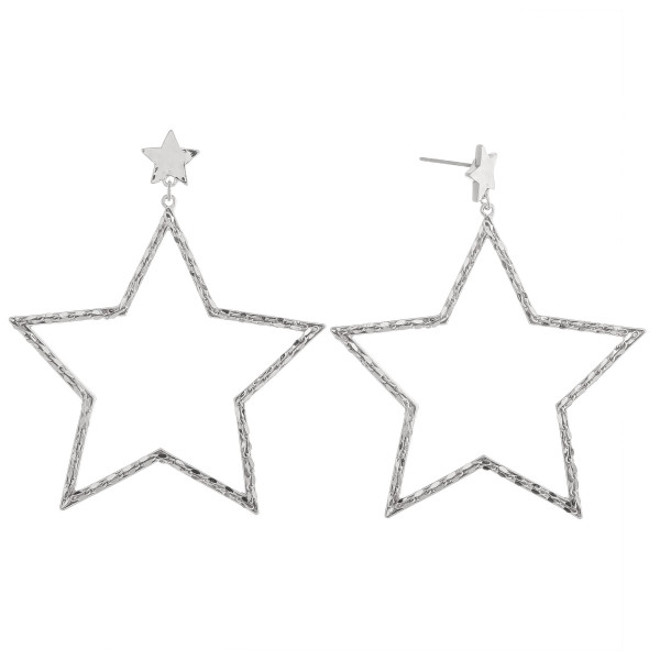 Silver star drop earrings featuring a braided texture.