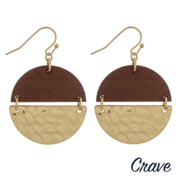 "Circular drop earrings featuring wood with gold metal accents. Approximately 1"" in diameter."