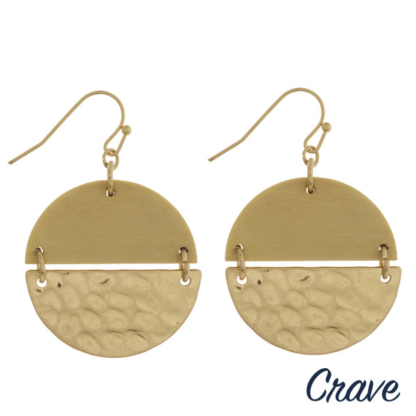 "Circular drop earrings featuring ivory wood with gold metal accents. Approximately 1"" in diameter."