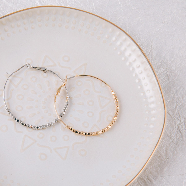 """Large circular drop earrings featuring gold accents. Approximately 2"""" in diameter."""