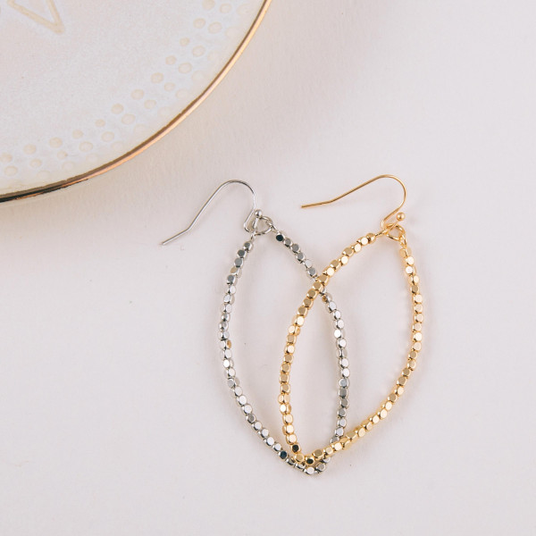 "Long drop earrings featuring metal beaded details. Approximately 2"" in length."