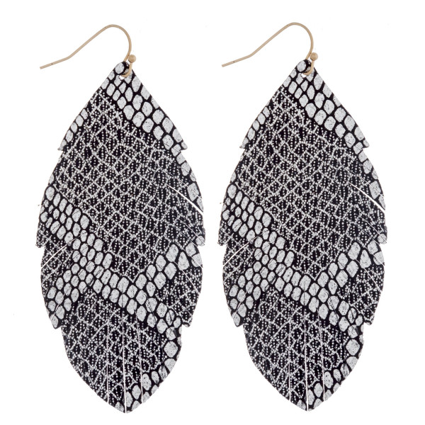 """Long feather inspired faux leather earrings featuring metallic snakeskin details. Approximately 3"""" in length."""