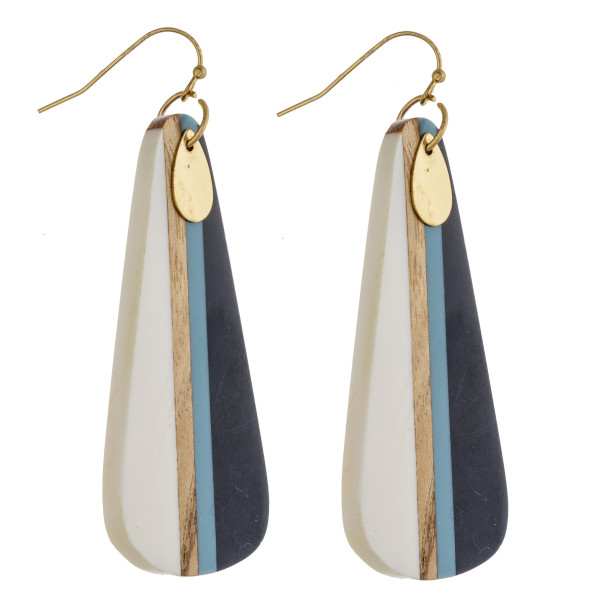 """Long resin teardrop earrings featuring wood inspired details with a gold teardrop accent. Approximately 3"""" in length."""