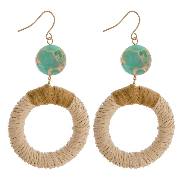 "Rattan woven circular earrings featuring raffia wrapped details and a natural stone accent. Approximately 2.5"" in length."