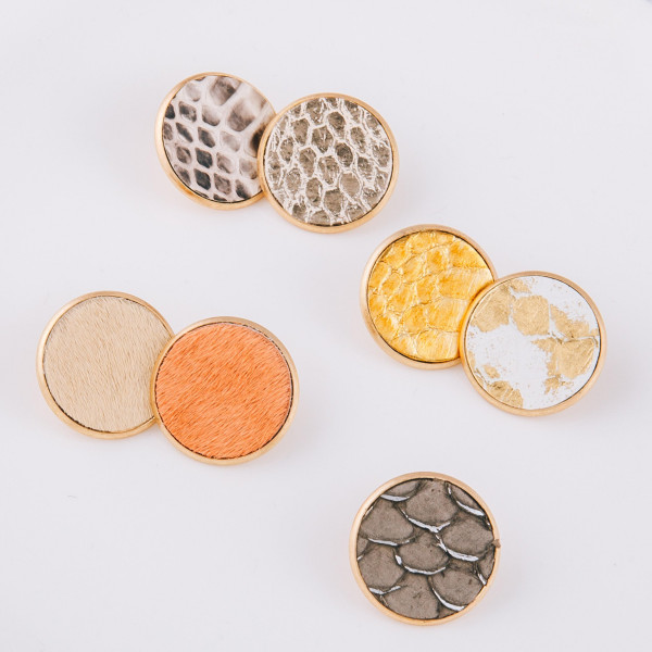 "Circular stud earrings featuring a fur genuine leather detail. Approximately 1"" in diameter."